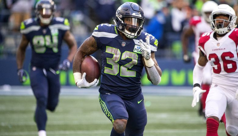 Seattle Seahawks running back Chris Carson (32) makes a 61-yard 3rd quarter break-away run as the Seattle Seahawks play the Arizona Cardinals at CenturyLink Field in Seattle on December 30, 2018.  (Mike Siegel / The Seattle Times)