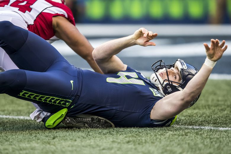 Seahawks punter Michael Dickson tries to recover a blocked punt, but the Cardinals recover it for a touchdown in the third quarter as the Seattle Seahawks take on the Arizona Cardinals for the final game of the regular season at CenturyLink Field in Seattle, Sunday December 30, 2018.  (Bettina Hansen / The Seattle Times)