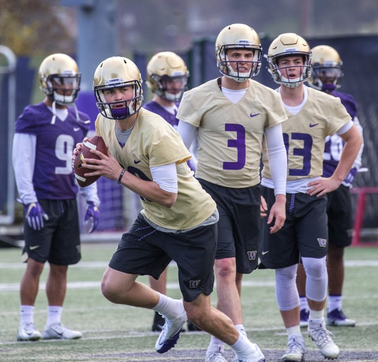 UW quarterback Jacob Eason on the first day of spring practice for the UW Husky football team on March 28, 2018. At center is Jake Browning.   (Mike Siegel / The Seattle Times)