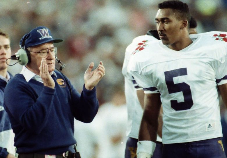 Don James talks with Dana Hall at the 1992 Rose Bowl against Michigan. (Rod Mar / The Seattle Times)