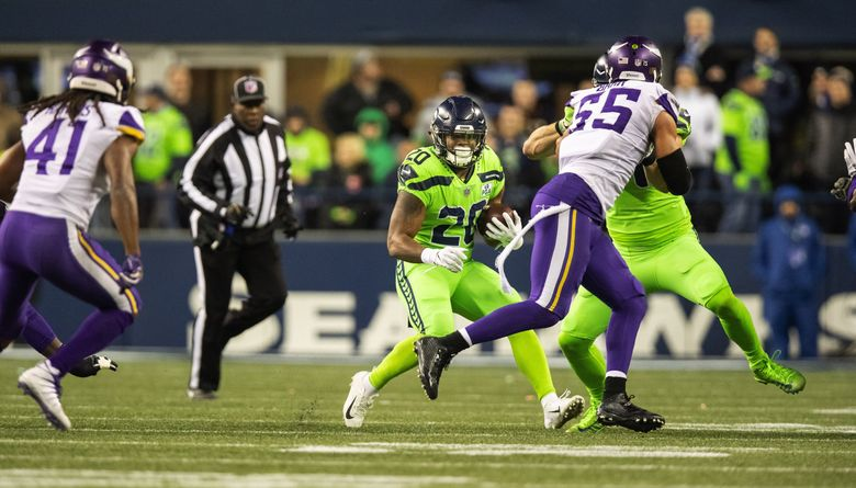 Seattle running back Rashaad Penny starts left, then cuts back against the grain to the right, and rushes for 17 yards in the 2nd quarter. (Dean Rutz / The Seattle Times)