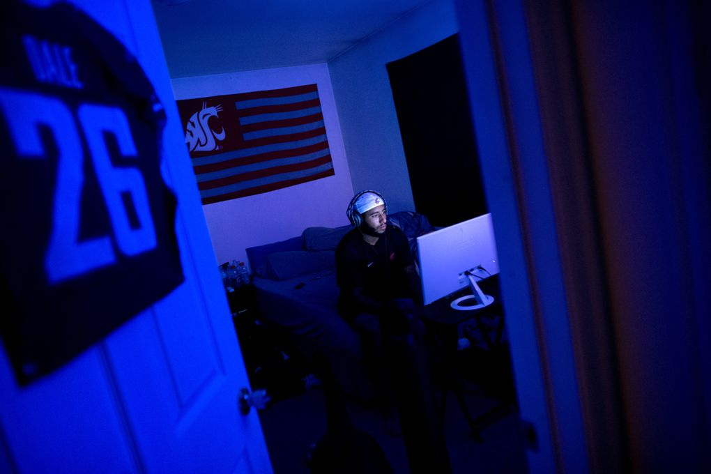 WSU safety Hunter Dale plays the popular video game Fortnite with teammates at his apartment in Pullman, Wash. (Tyler Tjomsland / The Spokesman-Review)
