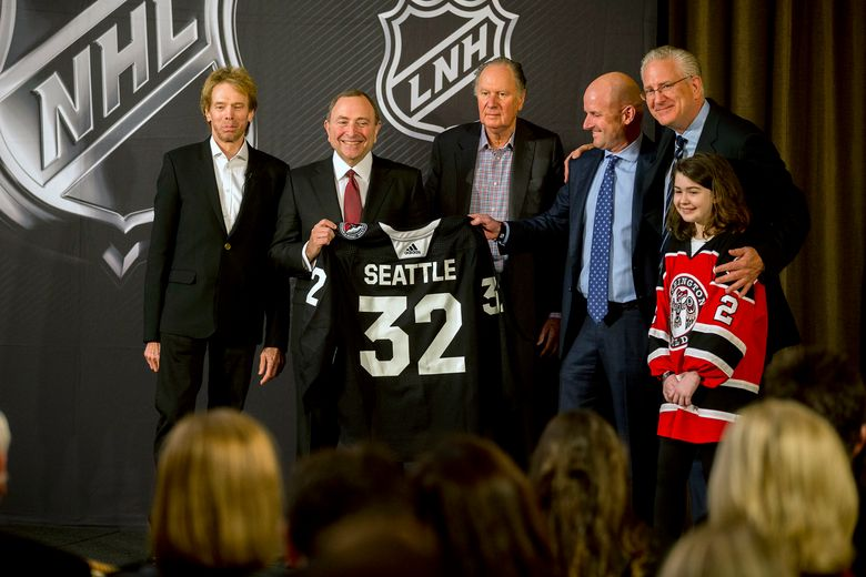 NHL commissioner Gary Bettman, center left, with members and supporters of Seattle's new NHL franchise in Sea Island, Ga. last week. Under Bettman, the NHL now has 23 billionaires among its 32 principal owners. (AP Photo/Stephen B. Morton)