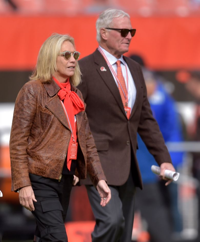 File-This Nov. 4, 2018, file photo shows, Cleveland Browns owners Dee and Jimmy Haslam walk on the field prior to an NFL football game against the Kansas City Chiefs, in Cleveland. The Browns owners have bought the Columbus Crew, guaranteeing the team will not relocate. The Haslams have been working for months with the a group to keep the Major League Soccer franchise in Ohio.  (AP Photo/David Richard, File)