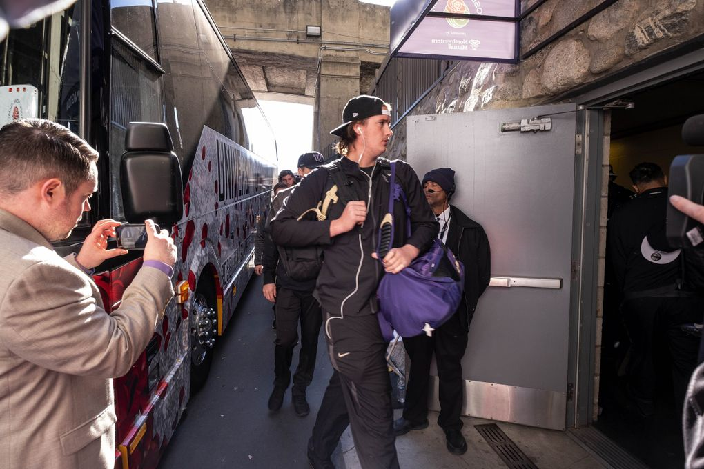 Trey Adams and the Washington Huskies arrive at the Rose Bowl for their New Year's matchup with Ohio State. (Dean Rutz / The Seattle Times)