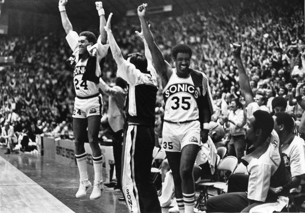 Jubilant SuperSonics raise their arms in a victorious salute near the end of their series-clinching playoff win over Portland on May 2, 1978. (Larry Dion / The Seattle Times)