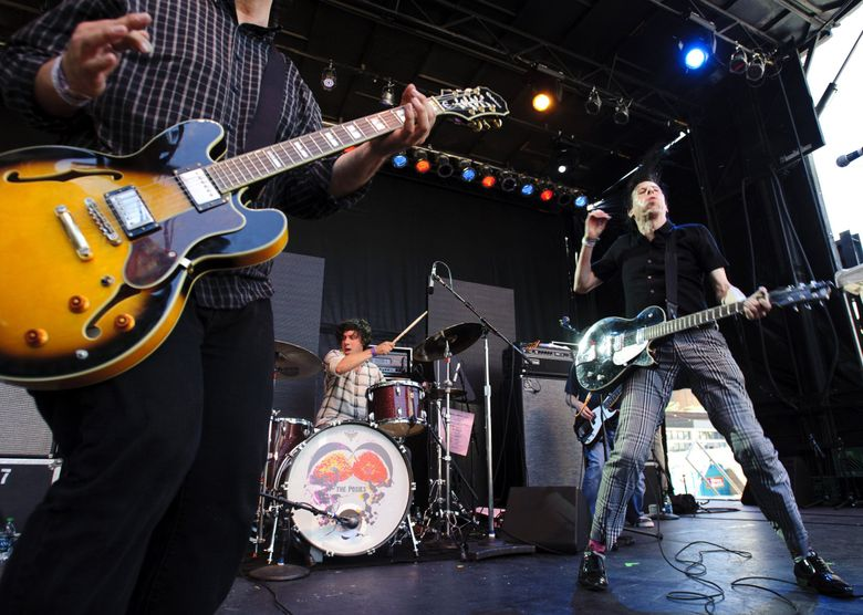 The Posies, with (from left) Jon Auer,  Darius Minwalla and Ken Stringfellow, performing at the Capitol Hill Block Party in 2011. (Joel Hawksley / The Seattle Times)