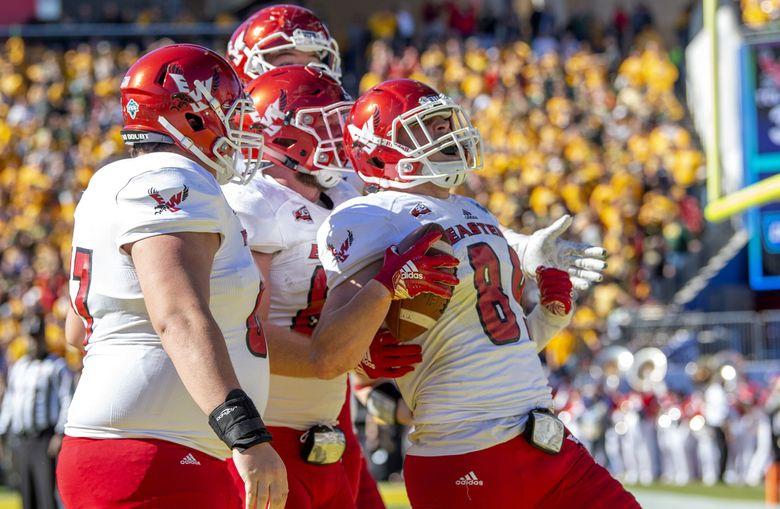 Eastern Washington tight end Jayce Gilder (89) is congratulated by offensive lineman D.J. Dyer, left; tight end Henderson Belk, middle; and wide receiver Champ Grayson, rear, after scoring on a fake field goal during the first half of the FCS championship NCAA college football game against North Dakota State, Saturday, Jan. 5, 2019, in Frisco, Texas.(Jeffrey McWhorter / The Associated Press)