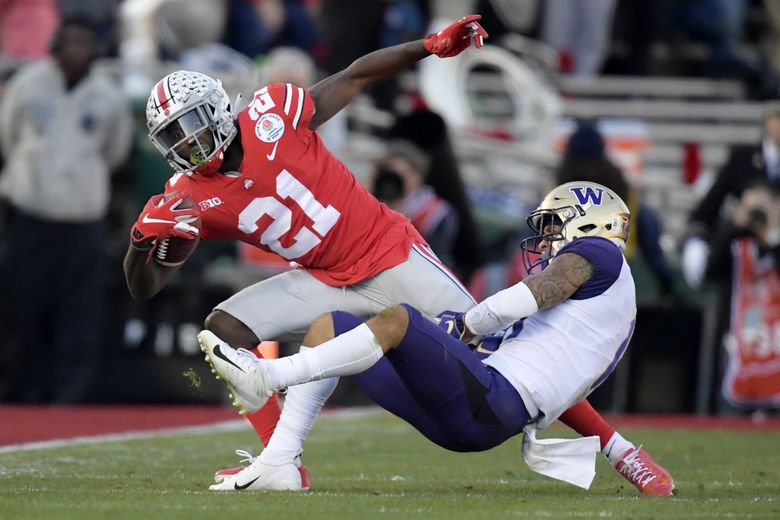 Ohio State wide receiver Parris Campbell is tackled by Washington defensive back Brandon McKinney in the Rose Bowl on Tuesday. (Mark J. Terrill / The Associated Press)