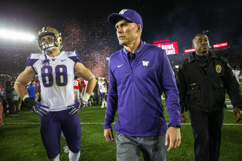 Washington coach Chris Petersen walks off the field  following the Huskies' 28-23 loss to Ohio State in the Rose Bowl. (Dean Rutz / The Seattle Times)