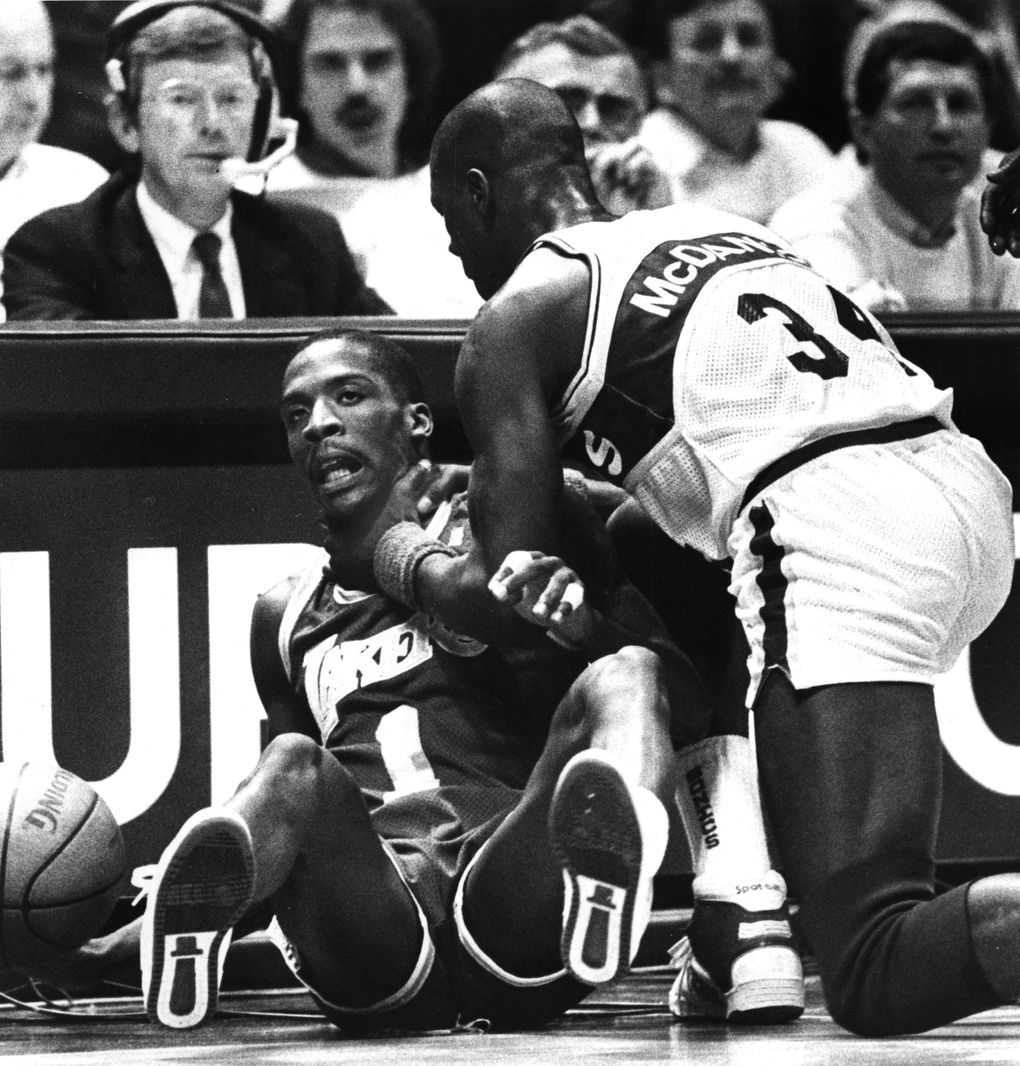 Xavier McDaniel of the Sonics gets a stranglehold on LA Laker Wes Mathews on Nov. 25, 1987.  (Harley Soltes / The Seattle Times)