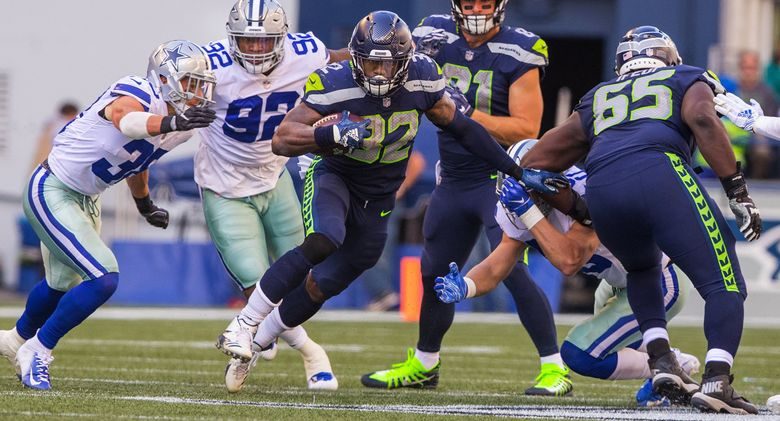 Seattle Seahawks running back Chris Carson rushed for 102 yards and a touchdown against the Cowboys in the regular season. (Mike Siegel / The Seattle Times)