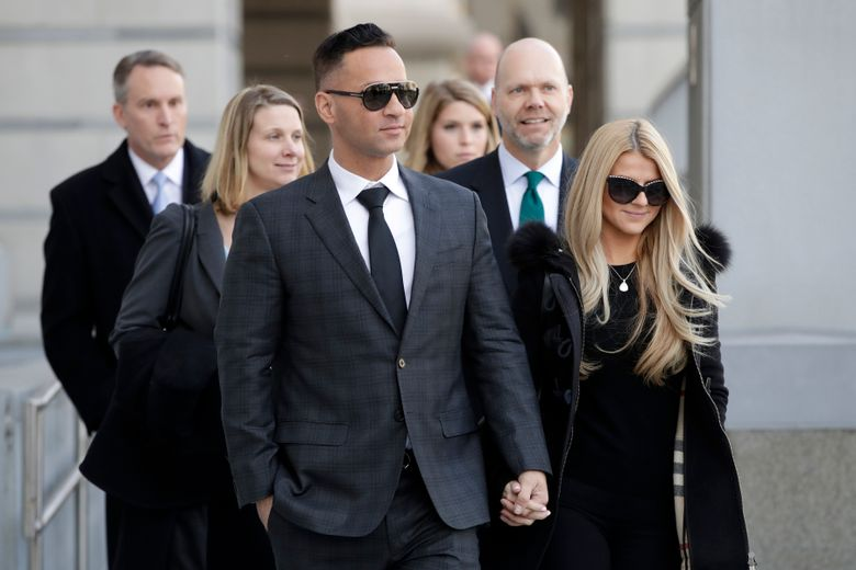 """FILE – IN this Jan. 19, 2018 file photo, Michael """"The Situation"""" Sorrentino, left, one of the former stars of the """"Jersey Shore"""" reality TV show, walks with his fiancee Lauren Pesce while leaving the Martin Luther King, Jr., Federal Courthouse after a hearing in Newark, N.J. Sorrentino is scheduled to report to Otisville Federal Correctional Institution in upstate New York on Tuesday, Jan. 15, 2019 to begin serving an eight-month sentence for tax fraud. (AP Photo/Julio Cortez, File)"""