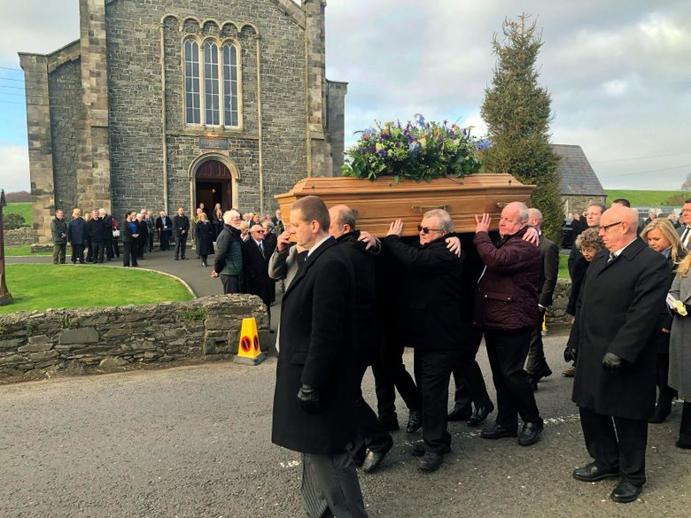 """Mourners carry the coffin at the funeral of Ulster historian and politician Dr Ian Adamson at Conlig Presbyterian Church in County Down, Northern Ireland, Monday Jan. 14, 2019. Van Morrison has performed one of his best-loved songs  """"Into the Mystic"""" – long seen as one of his most mysterious and evocative songs – at the funeral of his longtime friend the historian and politician Ian Adamson.(Michael McHugh/PA via AP)"""