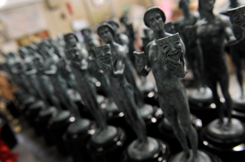 FILE – In this Jan. 9, 2014 file photo, finished Screen Actors Guild awards are pictured at American Fine Arts Foundry in Burbank, Calif. On Monday, Jan. 14, 2019, the Screen Actors Guild called on the film academy to stop preventing stars from appearing on award shows before the Oscars. In an unusually critical statement Monday, SAG-AFTRA said it has received multiple reports that the Academy of Motion Picture Arts and Sciences is pressuring actors to appear only at next month's Academy Awards. Several award shows occur before that, including the guild's own Screen Actors Guild Awards on January 27. (Photo by Chris Pizzello/Invision/AP, File)