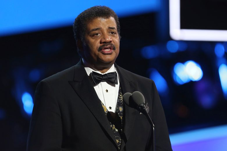 """FILE – In this Jan. 28, 2018, file photo, Neil deGrasse Tyson speaks at the 60th annual Grammy Awards at Madison Square Garden in New York. The current season of Tyson's """"Star Talk"""" series is on hold amid sexual misconduct claims against the prominent astrophysicist. National Geographic channel said Thursday, Jan. 3, 2019, that new episodes of the science-based talk show won't air until an investigation involving Tyson is completed. (Photo by Matt Sayles/Invision/AP, File)"""