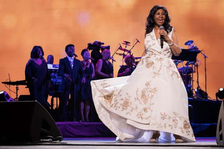 """FILE – In this April 19, 2017, file photo, Aretha Franklin performs at the world premiere of """"Clive Davis: The Soundtrack of Our Lives"""" at Radio City Music Hall, during the 2017 Tribeca Film Festival, in New York. The long-gesticulating Franklin biopic """"Respect"""" is going ahead with stage director Liesel Tommy set to direct. (Photo by Charles Sykes/Invision/AP, File)"""