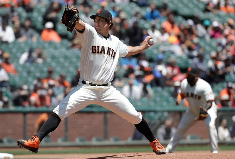 FILE – In this June 20, 2018, file photo, San Francisco Giants pitcher Derek Holland throws against the Miami Marlins during the first inning of a baseball game in San Francisco. Left-hander Derek Holland is staying with the San Francisco Giants. Holland has a $6.5 million salary this season as part of the deal announced Monday, Jan. 14, 2019, and the Giants have a $7 million option for 2020 with a $500,000 buyout. (AP Photo/Jeff Chiu, File)
