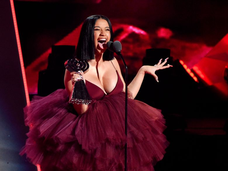 Cardi B accepts the Best New Artist award during last year's iHeartRadio Music Awards in Inglewood, Calif. She is blasting President Trump over the government shutdown. (Photo by Chris Pizzello/Invision/AP, file)