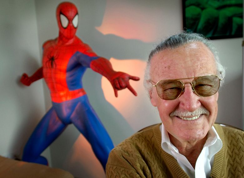 """This April 16, 2002 file photo shows Stan Lee, creator of comic-book franchises such as """"Spider-Man,"""" """"The Incredible Hulk"""" and """"X-Men,"""" posing near a Spider-Man figure in his Santa Monica, Calif., office. Friends, fans and family of Stan Lee will gather in Hollywood on Jan. 30 for a memorial honoring the life and work of late Marvel Comics mogul. (AP Photo/Reed Saxon, File)"""