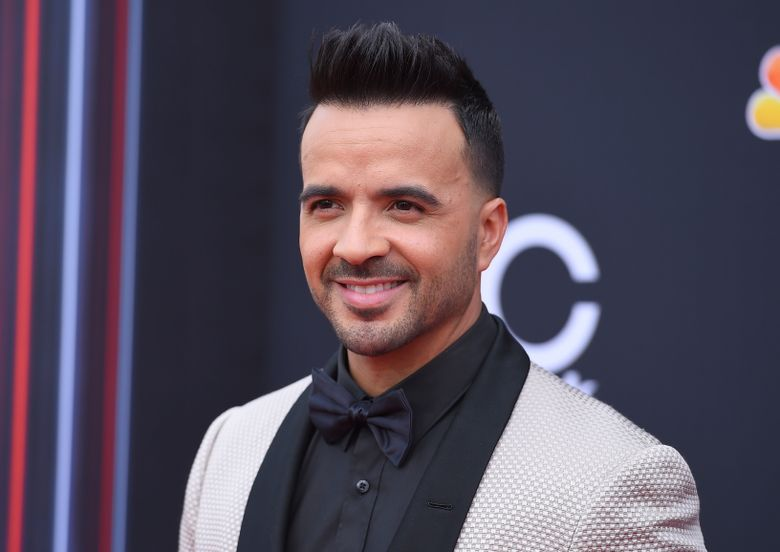 """FILE – In this May 20, 2018 file photo, Luis Fonsi arrives at the Billboard Music Awards in Las Vegas. Fonsi will release a new album, """"Vida,"""" on Friday, Feb. 1, 2019. (Photo by Jordan Strauss/Invision/AP, File)"""