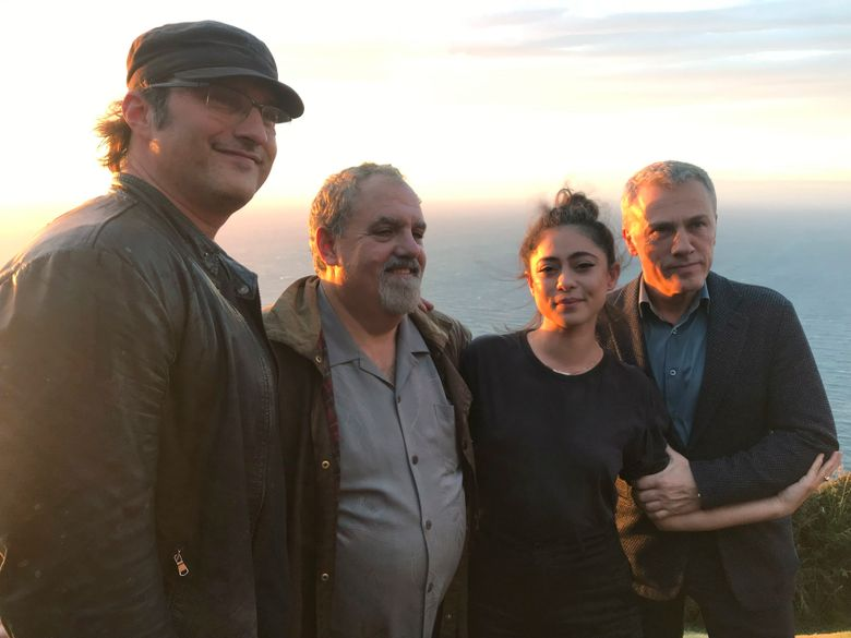 """In this photo taken on Jan. 9, 2019, from left, director Robert Rodriguez, producer Jon Landau, actors Rosa Salazar and Christoph Waltz pose for a photo near Wellington, New Zealand. The movie """"Alita: Battle Angel"""" has been 20 years in the making, and producer Jon Landau is confident it will finally signal a success for Hollywood in a genre which has proved problematic. (AP Photo/Nick Perry)"""