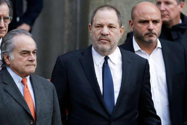 FILE – In this Thursday, Dec. 20, 2018, file photo, Harvey Weinstein, center, leaves New York Supreme Court with his attorney Benjamin Brafman, left, in New York. Brafman says Weinstein's sexual assault trial in New York is scheduled for May 6, 2019, but court officials say that's tentative and unofficial. (AP Photo/Mark Lennihan, File)