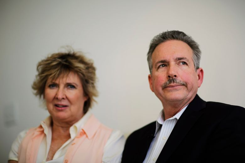 FILE – In this April 9, 2014, file photo, Richard Jones, right, sits next to wife Elizabeth as they sit in their attorney's office while talking about their daughter Sarah Jones, the 27-year-old camera assistant killed Feb. 20 by a freight train while filming a movie in southeast Georgia, in Atlanta. A railroad owner has settled a civil lawsuit by the family of a film worker killed in the 2014 train collision on its tracks in Georgia, ending the company's appeal of a $3.9 million jury verdict in the case. (AP Photo/David Goldman, File)