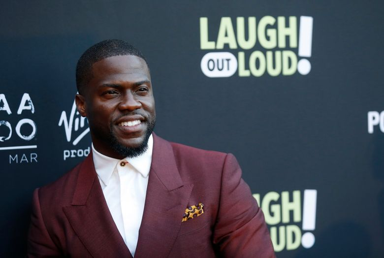 """FILE – In this Aug. 3, 2017 file photo, Kevin Hart poses at Kevin Hart's """"Laugh Out Loud"""" new streaming video network launch event at the Goldstein Residence in Beverly Hills, Calif.  Prodded by Ellen DeGeneres,  Hart says he'll reconsider his decision to step down as host of the Academy Awards. Two days after he was named as host last Dec. 2018, Hart backed off when some of his homophobic tweets from a decade ago resurfaced. (Photo by Danny Moloshok/Invision/AP, File)"""