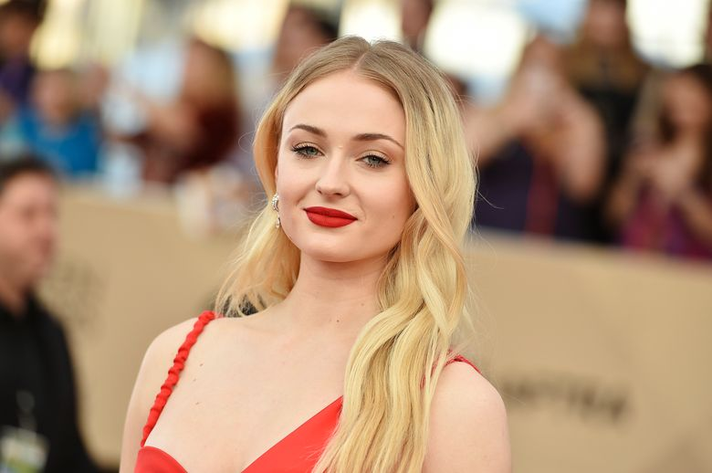 """FILE – In this Jan. 29, 2017, file photo, Sophie Turner arrives at the 23rd annual Screen Actors Guild Awards at the Shrine Auditorium & Expo Hall in Los Angeles. HBO announced Sunday night, Jan. 13, 2019, that the eighth and final season of """"Game of Thrones"""" will begin on April 14. In a one minute and 44 second teaser released Sunday, Arya Stark (Maisie Williams), Sansa Stark (Sophie Turner) and Jon Snow (Kit Harington) are seen in the crypts of Winterfell. (Photo by Jordan Strauss/Invision/AP, File)"""