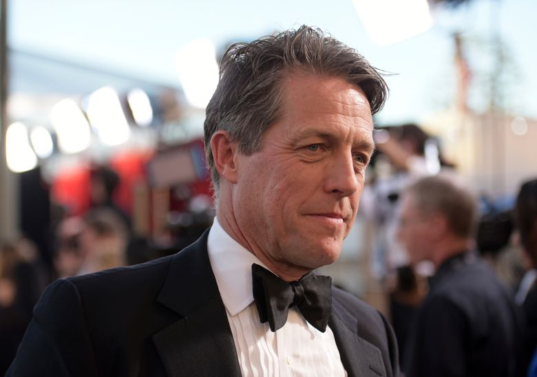 FILE – In this Sunday, Jan. 29, 2017 file photo, Hugh Grant arrives at the 23rd annual Screen Actors Guild Awards at the Shrine Auditorium & Expo Hall in Los Angeles. British actor Hugh Grant tweeted a plea to the thief who broke into his car late Sunday Jan. 13, 2019: Please return the script that was inside. (Photo by Richard Shotwell/Invision/AP, file)