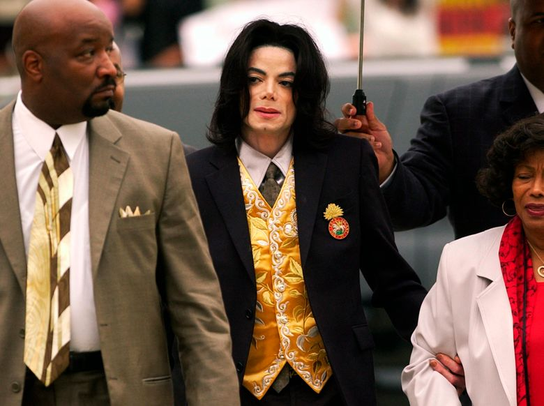"""FILE – In this May 25, 2005 file photo, Michael Jackson arrives at the Santa Barbara County Courthouse for his child molestation trial in Santa Maria, Calif. A documentary film about two boys who accused Michael Jackson of sexual abuse is set to premiere at the Sundance Film Festival later this month. The Sundance Institute announced the addition of """"Leaving Neverland"""" and """"The Brink,"""" a documentary about Steve Bannon, to its 2019 lineup on Wednesday. The Sundance Film Festival kicks off on Jan 24 and runs through Feb. 4. (Aaron Lambert/Santa Maria Times via AP, Pool)"""