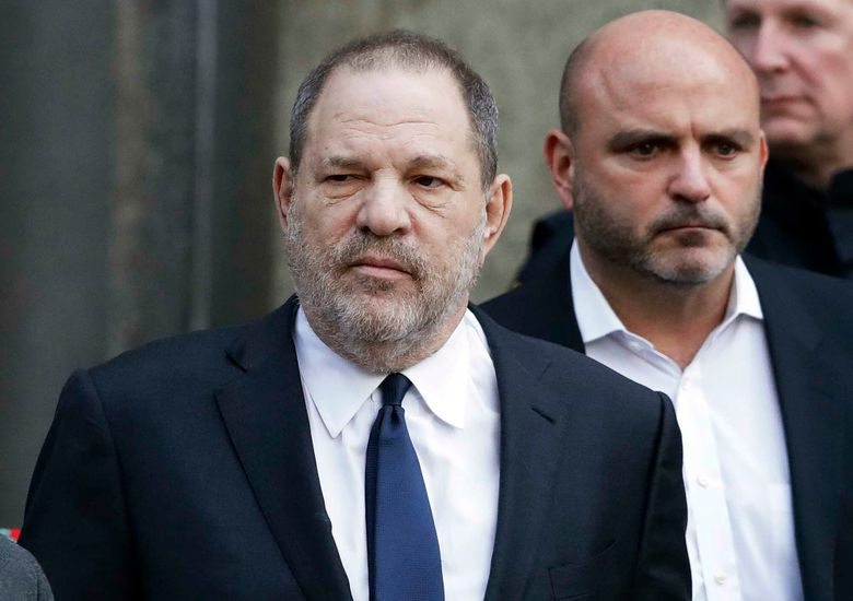 FILE – In this Thursday, Dec. 20, 2018, file photo, Harvey Weinstein, center, leaves New York Supreme Court in New York. Weinstein's lawyers say a New York judge should reject sex trafficking claims in a class-action civil lawsuit against the movie mogul. The lawyers said in papers filed late Monday, Jan. 28, that the law was aimed at stopping sex-trafficking rings or ventures that profit from the illicit sex trade. (AP Photo/Mark Lennihan, File)
