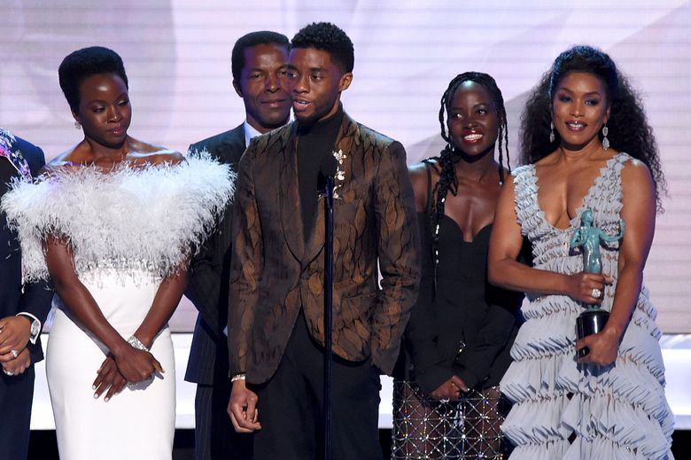 """Danai Gurira, from left, Isaach de Bankole, Chadwick Boseman, Lupita Nyong'o and Angela Bassett from the cast of """"Black Panther,"""" accept the award for outstanding performance by a cast in a motion picture at the 25th annual Screen Actors Guild Awards at the Shrine Auditorium & Expo Hall on Sunday, Jan. 27, 2019, in Los Angeles. (Photo by Richard Shotwell/Invision/AP)"""