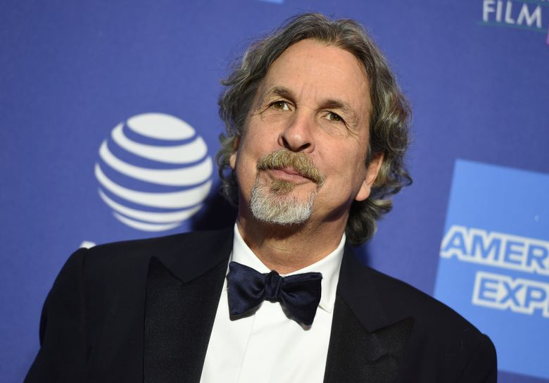 """FILE – In this Thursday, Jan. 3, 2019 file photo, Peter Farrelly arrives at the 30th annual Palm Springs International Film Festival in Palm Springs, Calif. Green Book"""" director Farrelly says he's deeply sorry and embarrassed after film website The Cut found an old story where colleagues said Farrelly liked to flash his genitals as a joke. The Cut on Wednesday, Jan. 9, 2019, published excerpts of a 1998 Newsweek story saying Farrelly liked to use ruses to get people to look at his penis. (Photo by Jordan Strauss/Invision/AP, File)"""