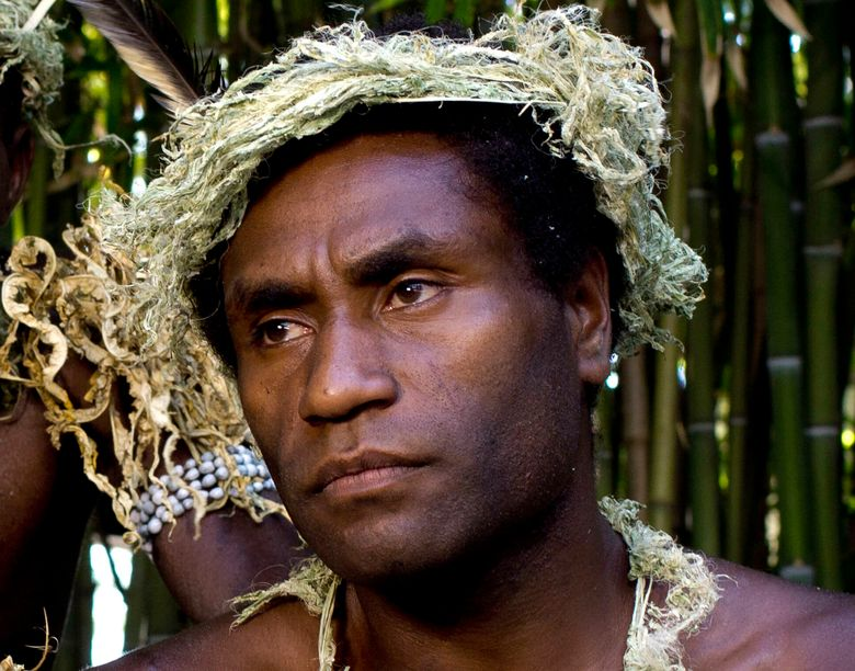 """FILE – This Sept. 9, 2015, file photo shows Mungau Dain in Venice, Italy. Dain had never considered acting before he starred in the Oscar-nominated film """"Tanna."""" He got the role because his elders decided he was the best-looking guy in their traditional village on the Pacific nation of Vanuatu. Dain died Saturday, Jan. 5, 2019,  in the capital Port Vila, after contracting a leg infection that wasn't quickly treated. He was in his mid-20s. (AP Photo/Domenico Stinellis, File)"""