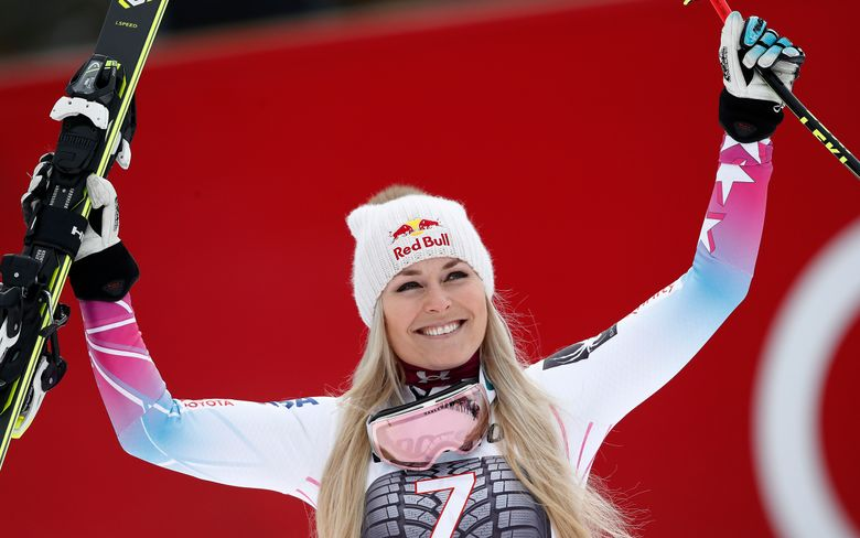 FILE – In this Feb. 4, 2018, file photo, United States' Lindsey Vonn celebrates on the podium after winning an alpine ski, women's world Cup downhill race, in Garmisch Partenkirchen, Germany. Lindsey Vonn is planning to return from injury this weekend, Jan. 12-13, 2019, for speed races in Austria, resuming her quest for the all-time record for World Cup wins. (AP Photo/Gabriele Facciotti, File)