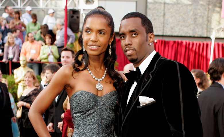 """FILE – In a Feb. 27, 2005 file photo, Sean """"P. Diddy"""" Combs arrives with date, Kim Porter, for the 77th Academy Awards in Los Angeles. Coroner officials say former model and actress Kim Porter died from pneumonia. The Los Angeles coroner's office on Friday, Jan. 25, 2019 released the results of its investigation into Porter's Nov. 15 death. Investigators determined after an autopsy that her death was from natural causes. (AP Photo/Amy Sancetta, File)"""