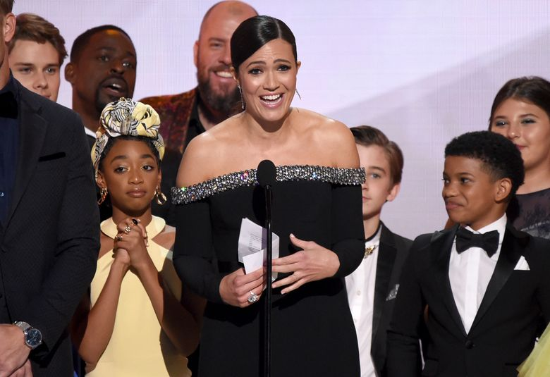 """Mandy Moore, center, and the cast of """"This Is Us,"""" accept the award for outstanding performance by an ensemble in a drama series at the 25th annual Screen Actors Guild Awards at the Shrine Auditorium & Expo Hall on Sunday, Jan. 27, 2019, in Los Angeles. (Photo by Richard Shotwell/Invision/AP)"""