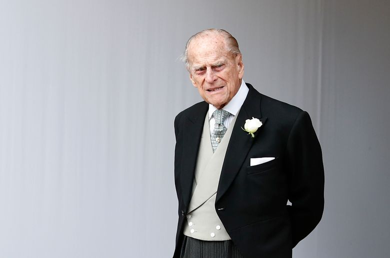 FILE – In this Friday, Oct. 12, 2018 file photo, Britain's Prince Philip waits for the bridal procession following the wedding of Princess Eugenie of York and Jack Brooksbank in St George's Chapel, Windsor Castle, near London, England. Prince Philip, the 97-year-old husband of Queen Elizabeth II, has apologized to a mother-of-two who was injured when the car she was riding in collided with a Land Rover he was driving on Jan. 17, 2019. (AP Photo/Alastair Grant, Pool)