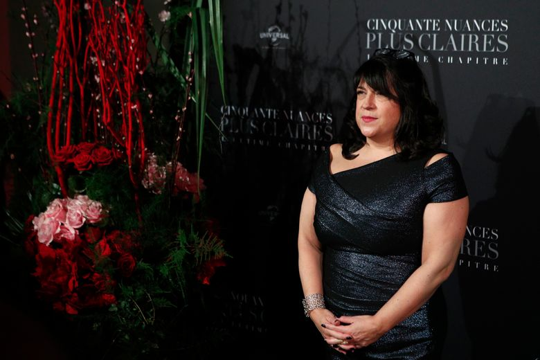 """FILE – In this Feb. 6, 2018 file photo, E.L. James poses during a photocall for the world premiere of 'Fifty Shades Freed – 50 Nuances Plus Claires' at Salle Pleyel in Paris. The author of the blockbuster """"Fifty Shades of Grey"""" trilogy has an """"erotic love story"""" coming out April 16, Vintage Books announced Thursday, Jan. 24, 2019.  It's called """"The Mister"""" and is another saga of sex, wealth and other indulgences. It features a rich Londoner who """"has rarely slept alone"""" and a beautiful woman who is an """"alluring mystery.""""(AP Photo/Francois Mori, File)"""