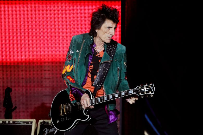 FILE – In this Saturday, Sept. 9, 2017 file photo, Ronnie Wood of the Rolling Stones performs during the first concert of their 'No Filter' Europe Tour 2017 in Hamburg, Germany. Rolling Stones guitarist Ronnie Wood might have a shot at winning the world's most grueling steeplechase for the first time with a not so wild horse. British Grand National organizers say Wood's horse, Sandymount Duke, is among 112 entries that will be whittled down to 40 runners for the race on April 6. (AP Photo/Markus Schreiber, File)