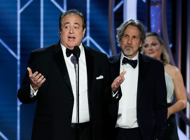 """FILE – In this Jan. 6, 2019 file image released by NBC, Nick Vallelonga accepts the award for best screenplay for """"Green Book"""" during the 76th annual Golden Globe Awards at the Beverly Hilton Hotel in Beverly Hills, Calif. Vallelonga apologized Thursday, Jan. 10 for a 2015 tweet about Muslims and 9/11 that has resurfaced. In the tweet, he said then-presidential-candidate Donald Trump was correct that television news on 9/11 showed Muslims in Jersey City cheering and he had seen it. There's no evidence such celebrations occurred.(Paul Drinkwater/NBC via AP, File)"""