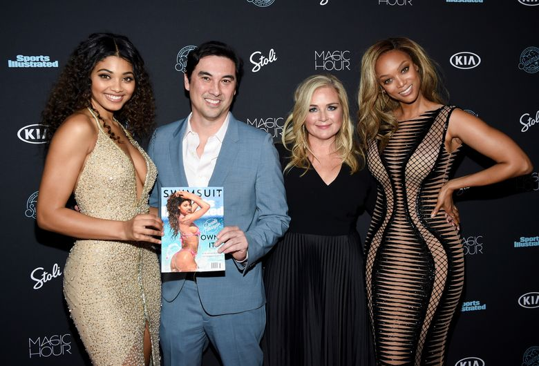 """FILE – In this Feb. 14, 2018 file photo, model Danielle Herrington,  from left, Sports Illustrated editor-in-chief Chris Stone, S.I. Swimsuit editor MJ Day, and model Tyra Banks attend the 2018 Sports Illustrated Swimsuit Issue launch party in New York. The upcoming Sports Illustrated Swimsuit Issue is moving its publication date, pushing it from the chill of February to warmer May, closer to bikini-weather. Editor of the issue MJ Day says the shift makes more sense for greater impact. She says; """"It's always hard to think about buying a swimsuit when its 18 degrees out.""""  (Photo by Evan Agostini/Invision/AP, File)"""