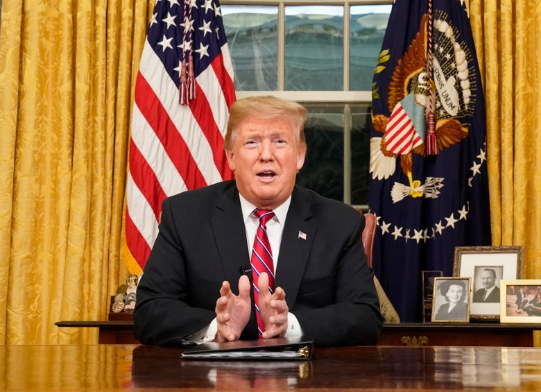 In this Jan. 8, 2019, photo, President Donald Trump speaks from the Oval Office of the White House as he gives a prime-time address about border security in Washington. (Carlos Barria/Pool Photo via AP)