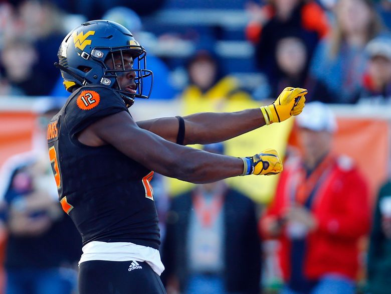 Wide receiver Gary Jennings, of West Virginia, celebrates after a touchdown during the second half of the Senior Bowl college football game, Saturday, Jan. 26, 2019, in Mobile, Ala. (AP Photo/Butch Dill)