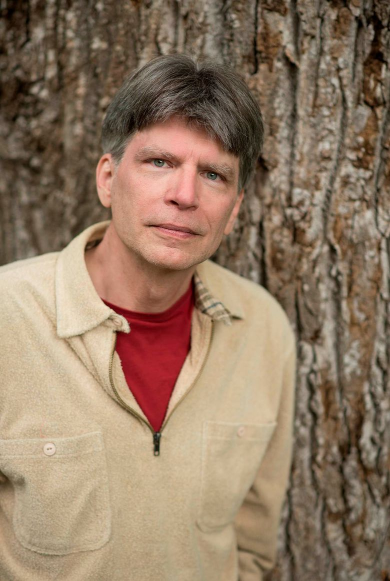 """This 2017 photo provided by W. W. Norton & Company shows author Richard Powers. Tara Westover's best-selling memoir """"Educated"""" and Powers' novel """"The Overstory"""" are among the nominees for a $75,000 award presented by PEN America, the literary and human rights organization. On Thursday, Jan. 24, 2019, PEN announced finalists for everything from translation to science to sports writing. (Dean. D. Dixon/W. W. Norton & Company via AP)"""
