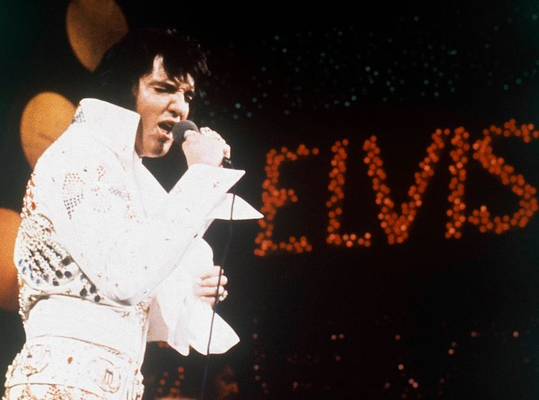 FILE – This 1972 file photo shows Elvis Presley, the King of Rock 'n' Roll, during a performance. Elvis Presley Enterprises says the auction of Elvis Presley-related memorabilia at The Guest House Graceland netted more than $600,000 Tuesday, Jan. 8, 2019. The Guest House is a hotel located steps from the Graceland home, where the singer lived in Memphis. (AP Photo, file)