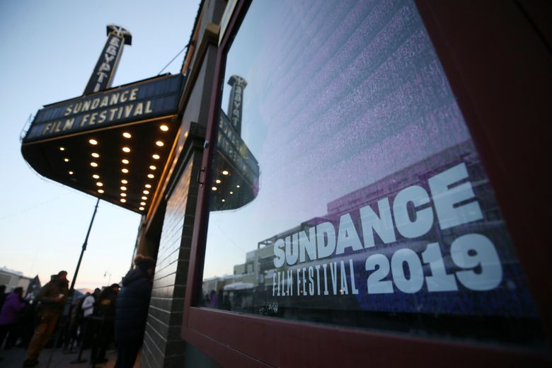 """The sun rises outside the Egyptian Theatre on Main Street beofre the morning premiere of the """"Leaving Neverland"""" Michael Jackson documentary film on Main Street during the 2019 Sundance Film Festival, Friday, Jan. 25, 2019, in Park City, Utah. (Photo by Danny Moloshok/Invision/AP)"""