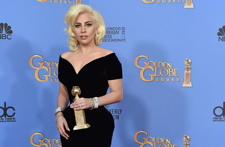 """FILE – In this Jan. 20, 2016 file photo, Lady Gaga poses in the press room with the award for best performance by an actress in a limited series or a motion picture made for TV for """"American Horror Story: Hotel"""" at the 73rd annual Golden Globe Awards at the Beverly Hilton Hotel in Beverly Hills, Calif.  Lady Gaga is poised to win not just one but two awards when the 76th annual Golden Globes get under way Sunday, Jan. 6, 2019.  (Photo by Jordan Strauss/Invision/AP)"""